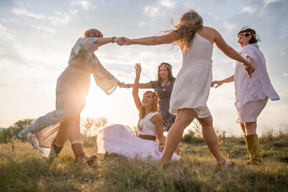Hippie girls having good fun time outdoors